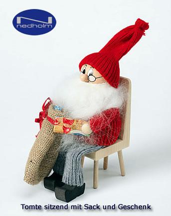 Swedish Tomte sitting with sac/present, h 23 cm