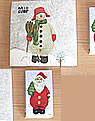 Matchbox and napkins Santa Claus