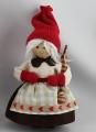 Femme de Père Noel avec du cadeau, 14 cm