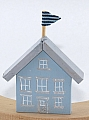 wooden house with flag, height 8 cm, light blue