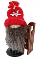 Winter Tomte with sledge and knitted cap, H 8 cm, red/grey